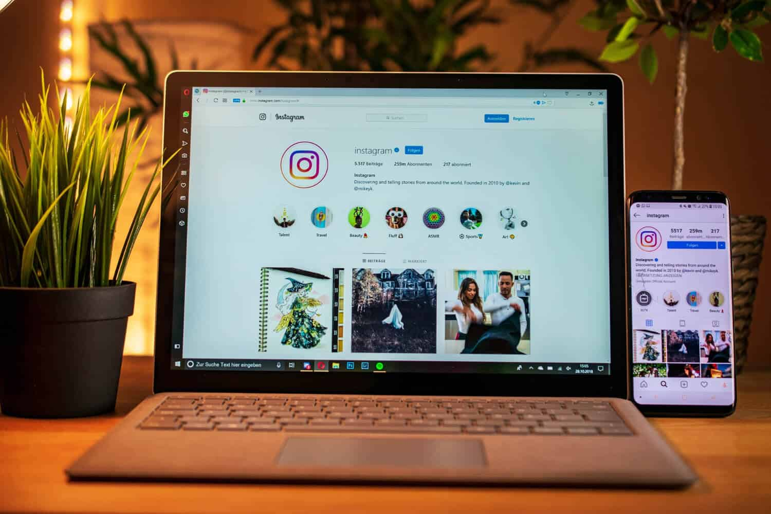 Instagram App Open On Laptop and Cellphone