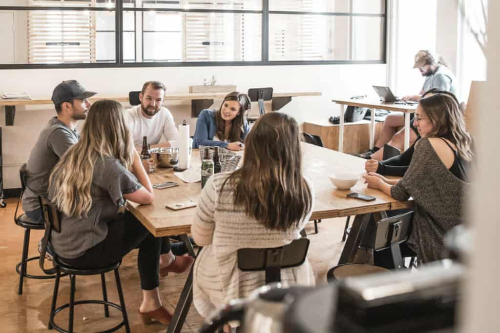 Group of coworkers sitting at table having a meeting