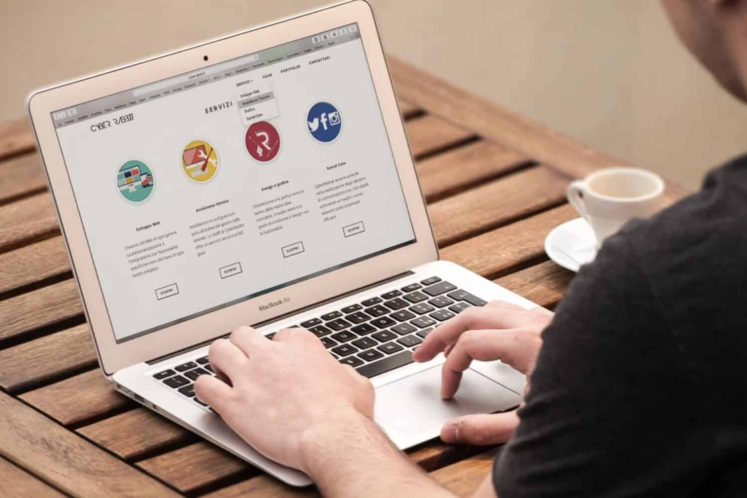 person viewing website landing page on laptop