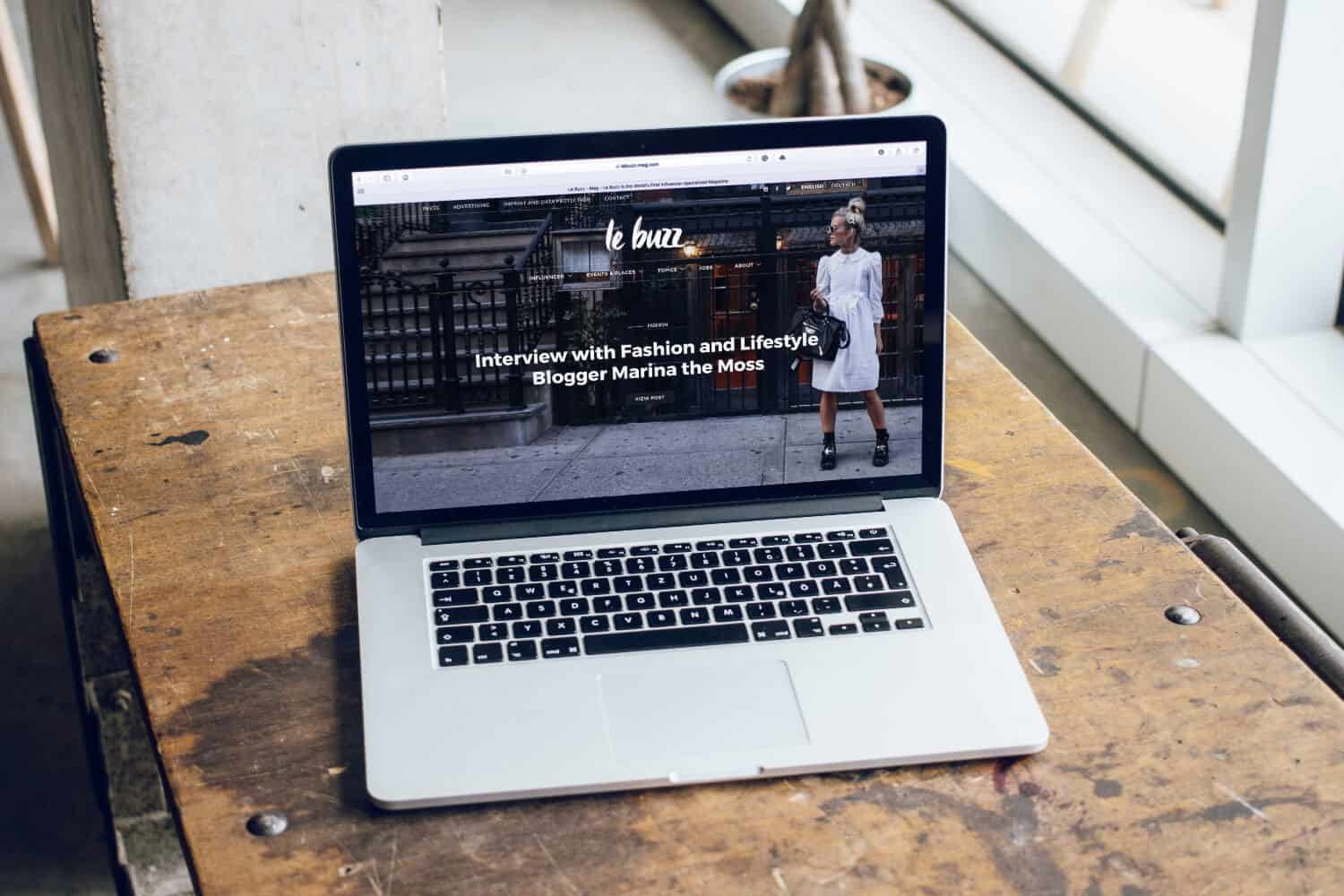 Laptop on a table with website landing page open