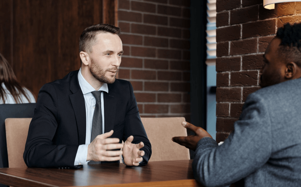 Two businessmen discussing something in meeting