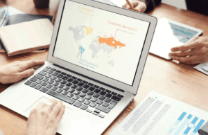 Laptop screen showing global business map