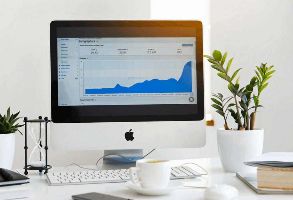 Desktop computer sitting on desk showing website analytics