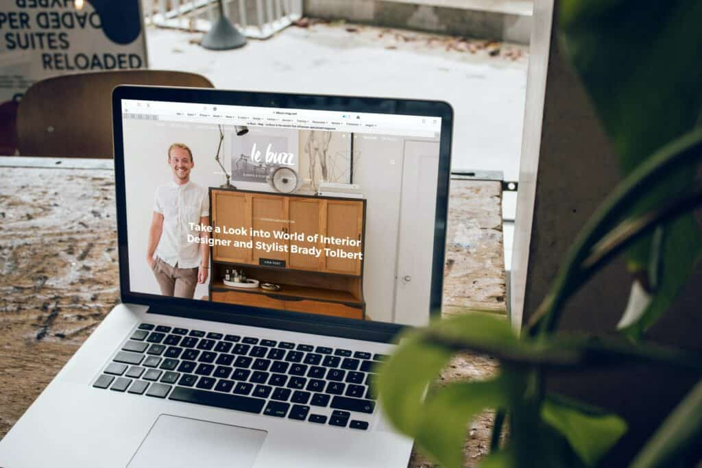 Laptop on desk with website landing showing