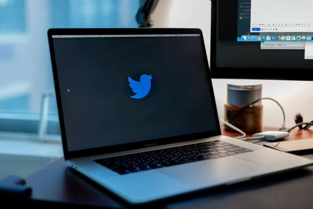 Laptop with Twitter logo on screen