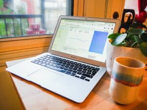 Laptop on table showing Google analytics page